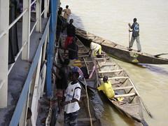 Fishermen sell fish to passengers
