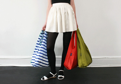 shopping bags held by a girl
