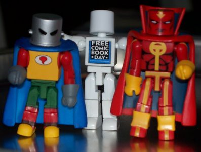 The original and modern Red Tornados pose with Free Comic Book Day Man!