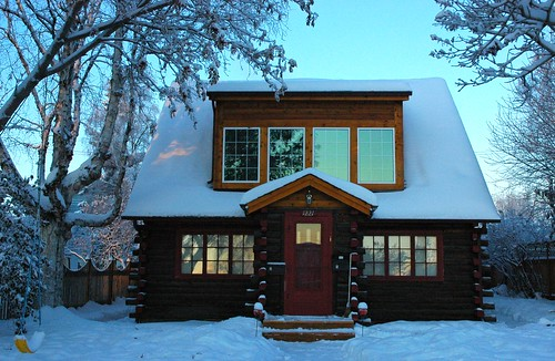 Fresh snow and log house