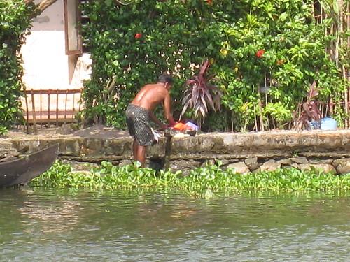 man washing clothes