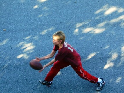 Catching a football (Have you figured out his love of football yet?)