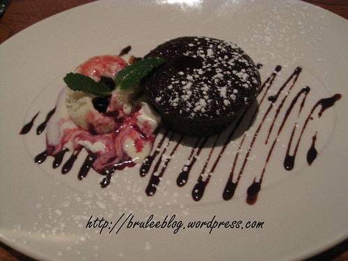 Individually baked warm chocolate cake served with vanilla bean ice cream