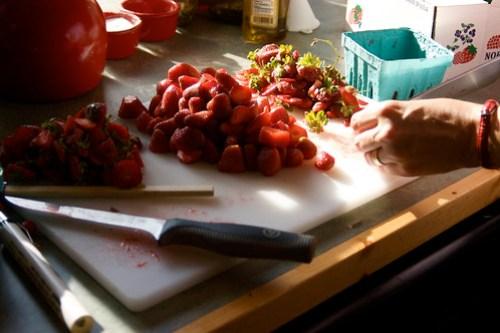 preparing strawberries for jam