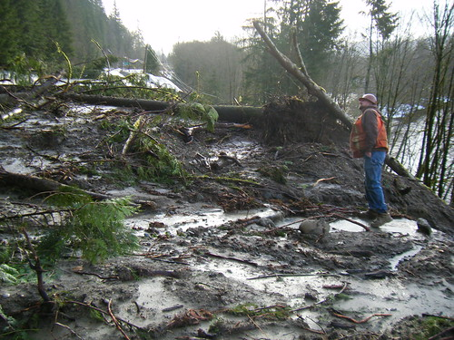 Crews start clearning mud from SR 20 by Washington State Dept of Transportation.