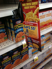 Grocery Coupons - Tearpad shelf display of cou...