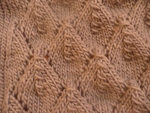 http://www.ravelry.com/patterns/library/06-long-jacket-with-eyelet-pattern