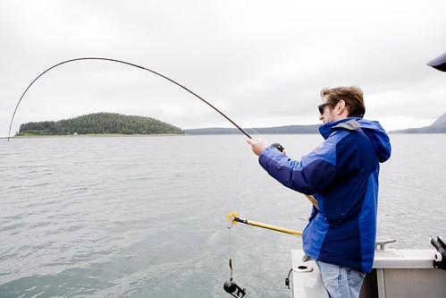 Mark with fish on, Yakutat Alaska