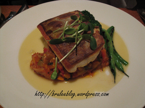 Seared Arctic char with ratatouille, roast garlic butter sauce and mashed potatoes