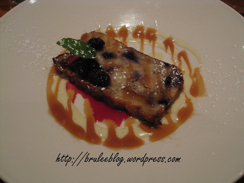 Blueberry and white chocolate bread pudding served warm with creme anglaise