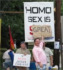 gay counterprotest sign