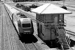 Down daylight XPT service to Melbourne arriving into Yass Junction station, passing the old signal box.