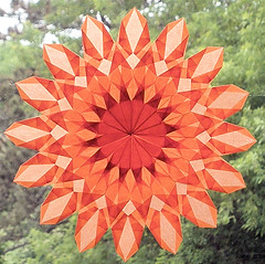 Orange Sunburst Star with 16 Points