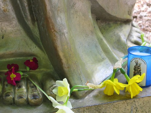 Flowers at the statues feet.