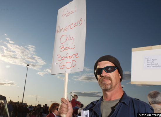 "Republican ""tea party"" protester's sign says 'Real Americans Only! Bow Before GOD'"