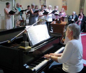 Music director Judy Putnam and the NSUU Singing Group.