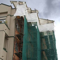 condo covered with tarp