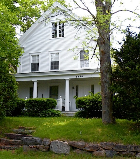 White clapboard antique house in Barnstable, Cape Cod, MA