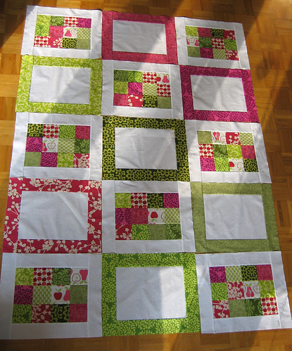 Green and pink quilt laid out