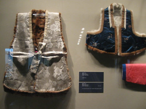 for added warmth, these fur-lined vests were worn on top