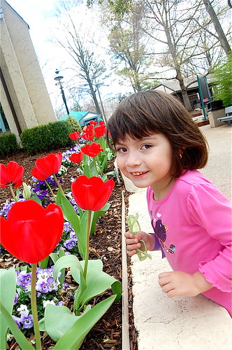 Taking a moment to smell the tulips. The landscaping is beautiful!