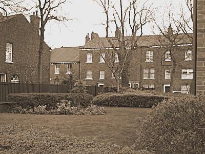This is looking across the gardens of Fairfield Court, an old peoples home, from the main road, towards the settlement.