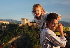Claire on Stu's shoulders in front of the Al-Hambra in Granada