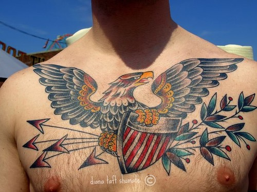 Di · Untitled · Eagle/ Shield chest tattoo by Berkhardt at Top Shelf in