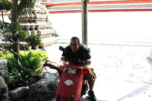 On Bike in Wat