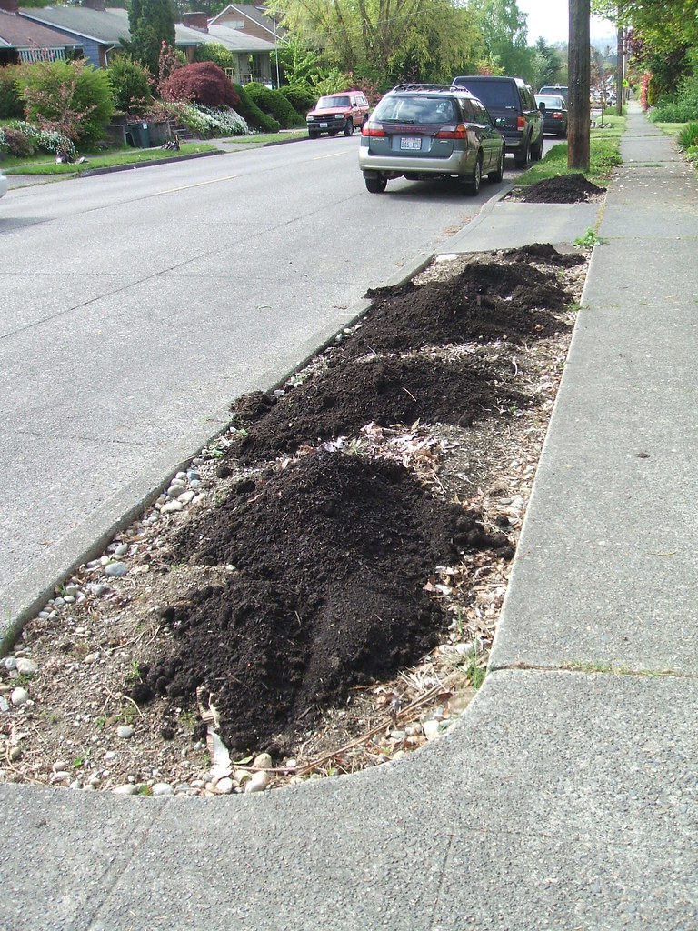 Compost piles on parking strip