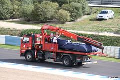 El BMW Sauber F1.09 en la grúa