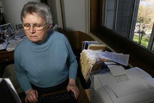 """Legislative library worker Hilda Hartling pulls up articles dating back to the 1800s from the State Historical Society of Missouri's newspaper archive Web site in the statehouse library on April 8. Hartling said she does not know how she managed to get the desk with the best view in the library – """"just luck,"""" she said."""