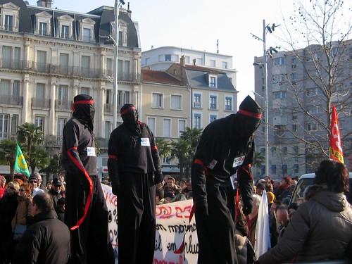 Stilt ninjas at the Valence protest.