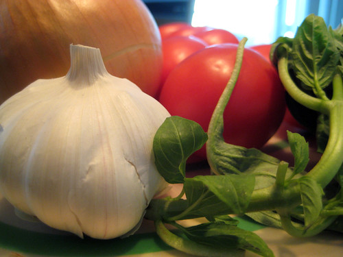 Raw Garlic, Onion, Roma Tomatoes and basil
