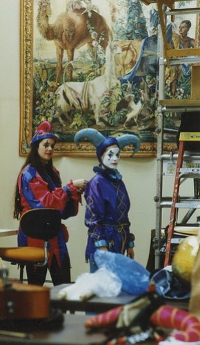 Marcia helping Daphne get dressed as a harlequin.