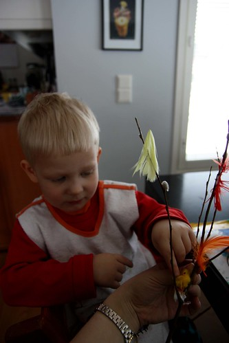 Niilo decorating the willow twigs