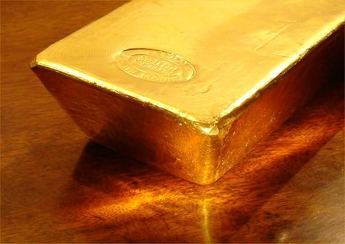 Gold Bar on Polished Wood