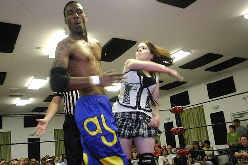 Williams reels from a slap by Destiny Diamond during their intergender tag team match in East Carondelet, IL on May 23. Photo by Mike VanHoogstraat