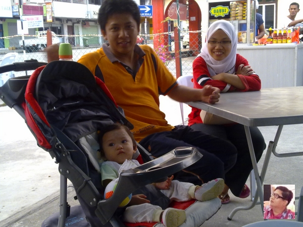 Madam Midah,her husband and a very adorable daughter.