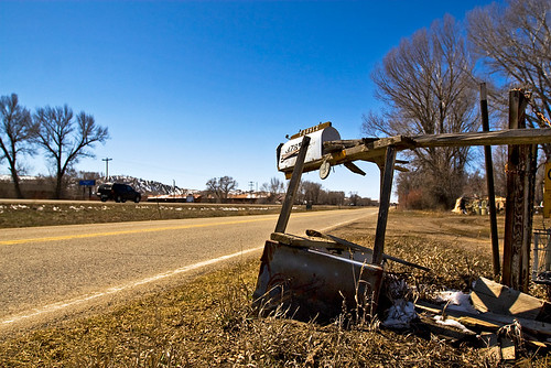 The houses mailbox, located on a frontage road alongside the highway.
