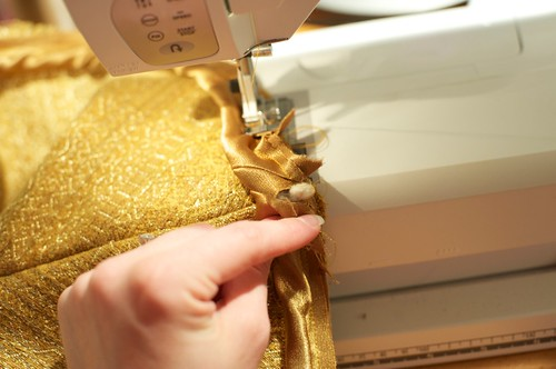Fold fabric while sewing