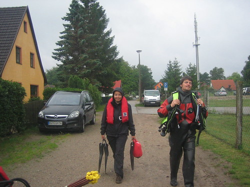 Cate and Christian heading for the boat, for the first dive of the day.