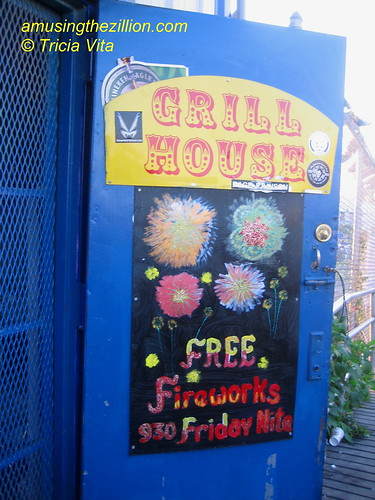 Coney Island Fireworks sign on the door of Steves Grill House on the Boardwalk. Photo © Tricia Vita/me-myself-i via flickr