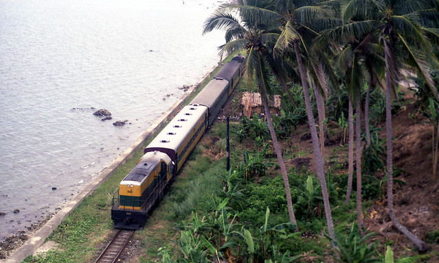 Philippine National Railways (PNR) southbound passenger with diesel locomotive 2522 trailing at northern end between Atimonan and Gumaca, Quezon, Philippines.