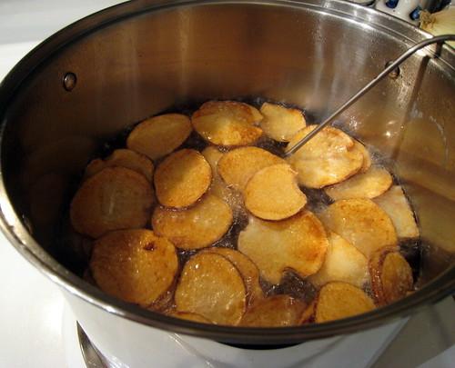 Frying potato chips.