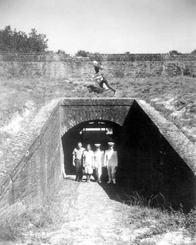 Two officers along with a couple walking through the sally port of Fort Barrancas: Pensacola, Florida