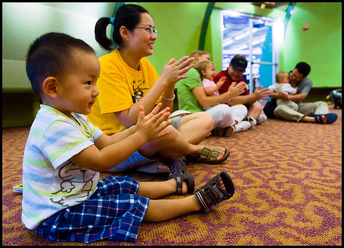 Jing Han and 2-year-old Kevin Han at Rhymes and Rhythms for Pre-Walkers in the Columbia Public Library on Tuesday.
