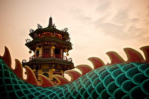 Sunset over a dragons back at the Spring and Autumn Pavilions in Kaohsiung, Taiwan.