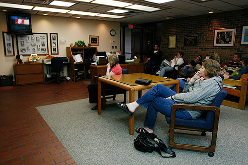 Judy Brivitt (foreground) watches a livecast of the Columbia School Board candidate forum in another room of the District Administration Building on March 16. The room in which the forum was held was standing room only, forcing other attendees to watch the livecast nextdoor.