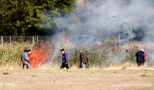 A Grass fire on Somnes Avenue Canvey Island is tackled by members of a nearby model club.